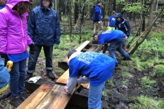 Puncheon Crew repairing a bridge on a trail behind the HNC